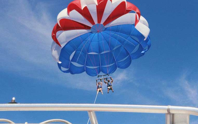 Couple on a tandem Parasailing Flight Trip over the Los Cabos Arch