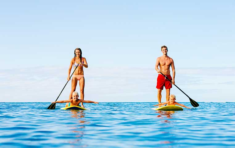 Couple on Stand Up Paddles in the Cabo Ocean