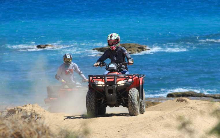 2 ATV riding on an Incredible Beach with dunes in Cabo San Lucas