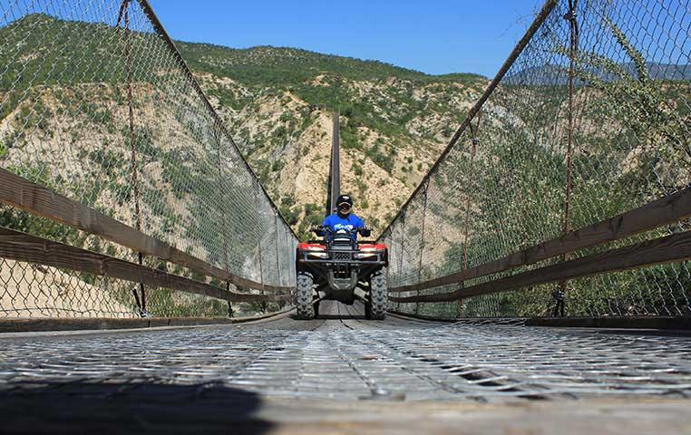 ATV driving down a huge Wooden Suspension bridge in Cabo San Lucas