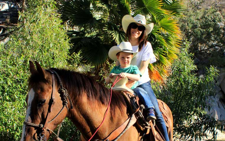 Mom and Son riding a Horse in the Los Cabos Wild Canyon Park