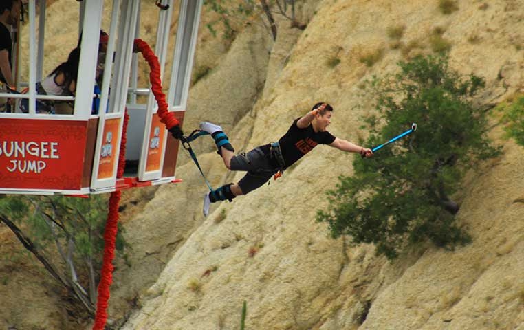 Man jumping out of Gondola in Cabo San Lucas to free fall 300 Feet into Wild Canyon