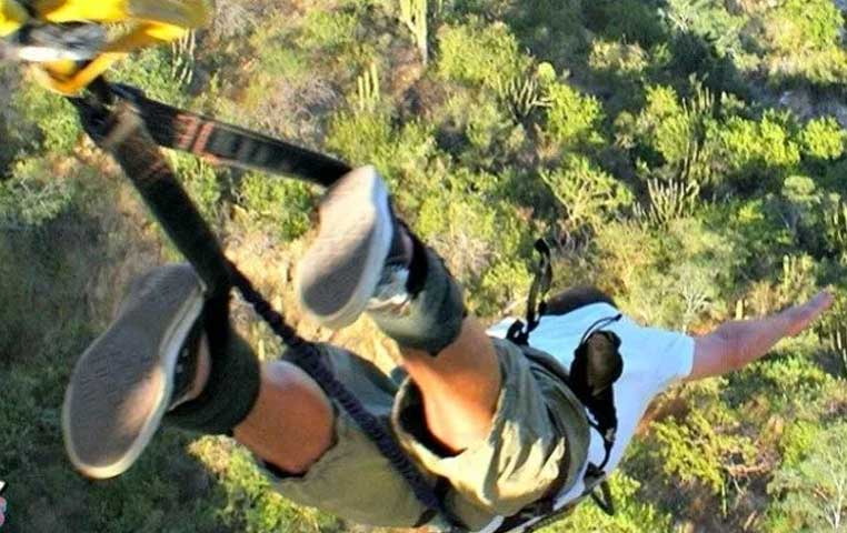 A man Bungee Jumping in Cabo San Lucas from 300 Feet of height