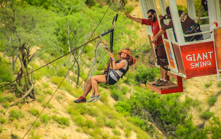 Couple ready to Swing 300 Feet into the Wild canyon Eko Park in Cabo