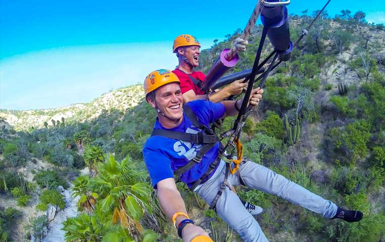 Couple Swinging 300 Feet into the Wild canyon Eko Park in Cabo