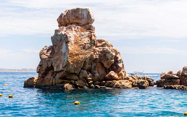 Rock Formation at Lands End close to the Arch surrounded by Water in Cabo